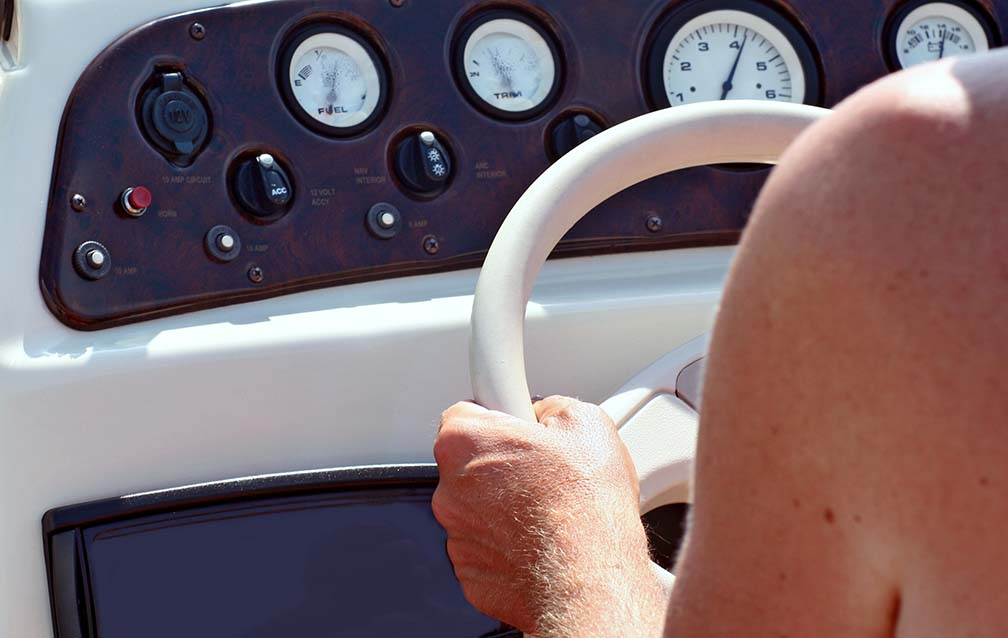 Woman driving a speed boat