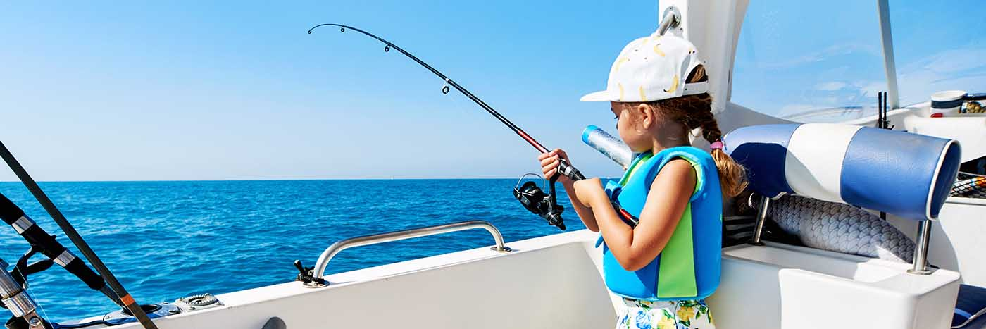 Little girl fishing on a charter boat