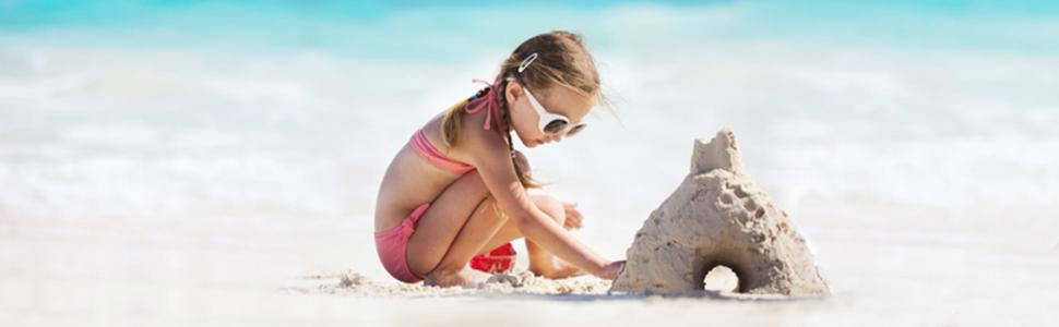 Girl making a sandcastle in Destin, Florida