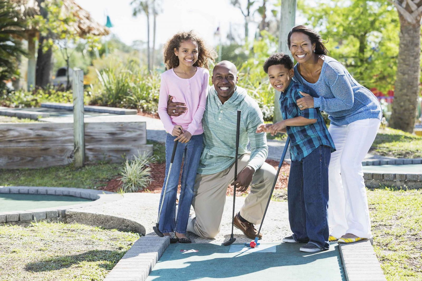 Family at Island Themed Mini Golf Course