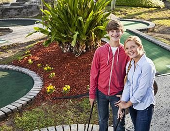 Teenagers on a date at a putting course