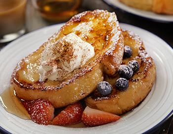 French Toast with Whipped Cream and Fruit