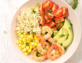 Build your own shrimp bowl with corn and avacado
