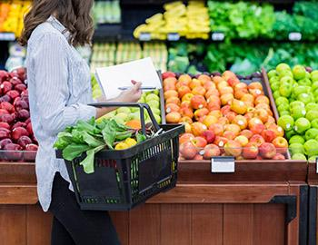 Woman grocery shopping at store