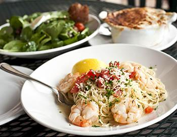 Shrimp Scampi, salad and lobster bisque from a restaurant
