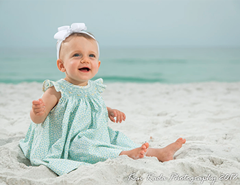 Young girl on beach photo by Ken Rada Photography