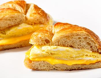 Croissant breakfast sandwich with eggs and cheese