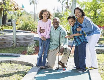 Family at Tropical Themed Mini Golf Course