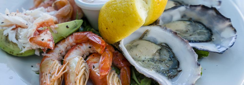 Assorted seafood plate with oysters, shrimp and more