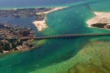 aerial view of crab island in destin florida with boaters at the sand bar